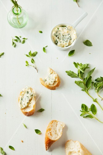 Homemade herb butter and slices of baguette