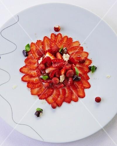 Strawberry carpaccio with wild strawberries