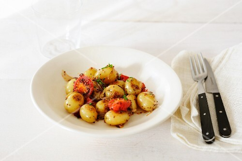 New potatoes with cherry tomatoes and mustard