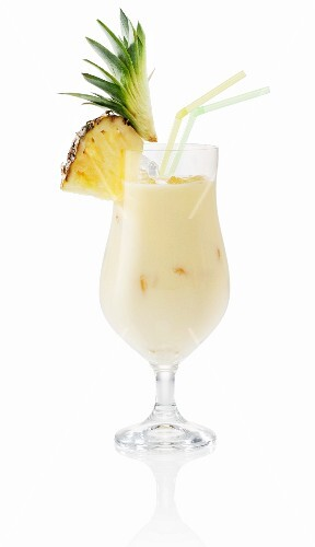 A Pina Colada garnished with fresh pineapple
