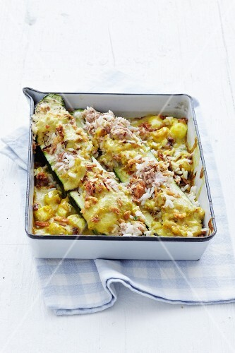 Courgette with tuna and rice in a baking dish