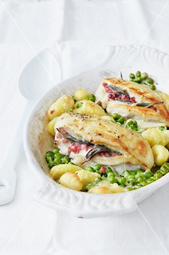 Chicken saltimbocca on a bed of gnocchi with peas
