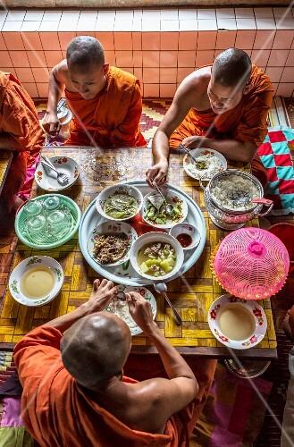Buddhist monks eating, Battambang, Cambodia