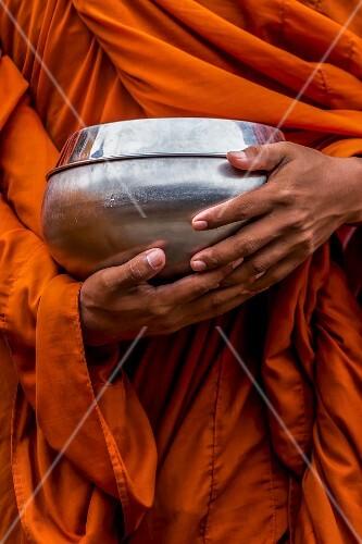 A Buddhist monk waiting to receive alms, Battambang, Cambodia