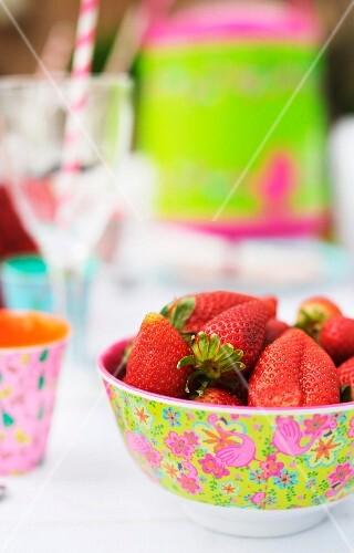 Strawberries in floral plastic bowl