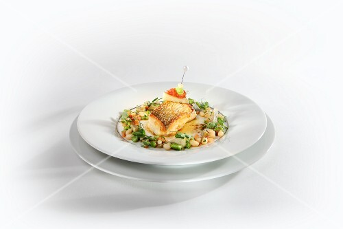 Souffléd grayling with scallops served with spiced butter and beans