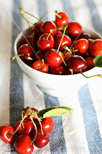 Cherries in a white porcelain bowl