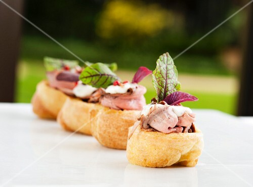Yorkshire puddings topped with roast beef