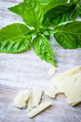 Basil and Parmesan on a wooden surface