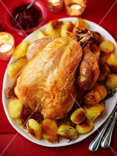 A whole roast turkey with roast potatoes and red cabbage for Christmas