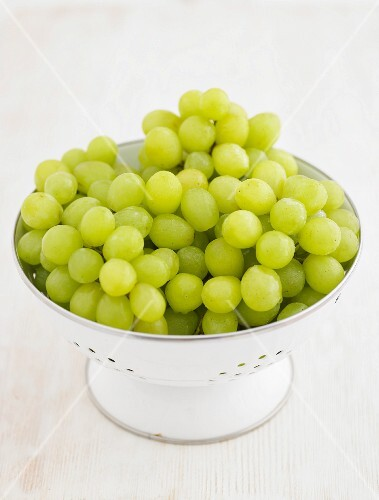 Green grapes in an enamel colander
