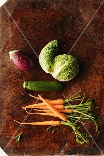 Various types of vegetables on a wooden surface