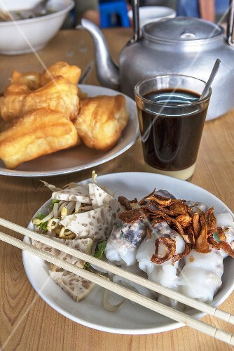 Breakfast featuring Vietnamese Banh Cuonrice paper rolls, coffee and doughnuts (Vientiane, Laos)