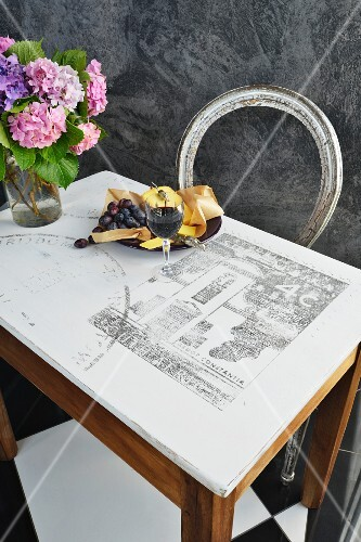 A tabletop printed with a blown up picture of a French postage stamp