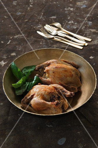 Spring chicken with couscous and porcini mushroom stuffing