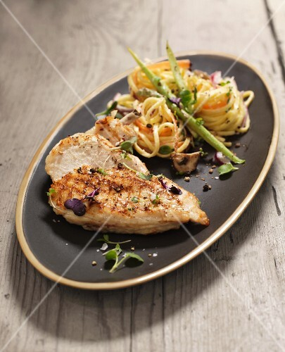 Fried chicken breast with noodle salad
