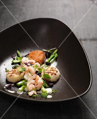 Cod with asparagus, scallops and prawns