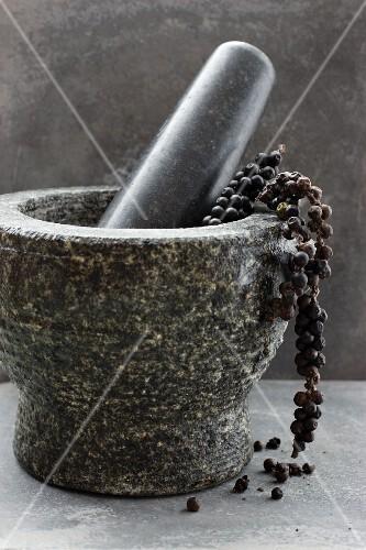 Black pepper in a mortar