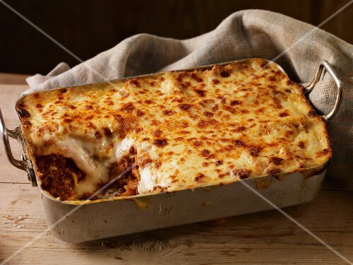 Lasagne in a baking dish, one slice removed