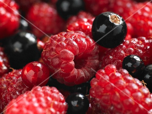 Close-up of raspsberries, blackcurrants and redcurrants