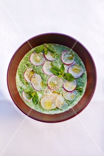 Courgette soup with soy yogurt, vanilla and radishes