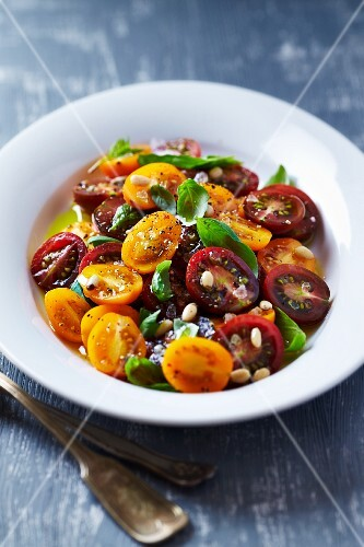 Cherry tomatoes with pine nuts, basil and sea salt