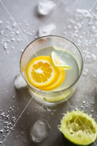 A glass of refreshing citrus water with slices of fruit