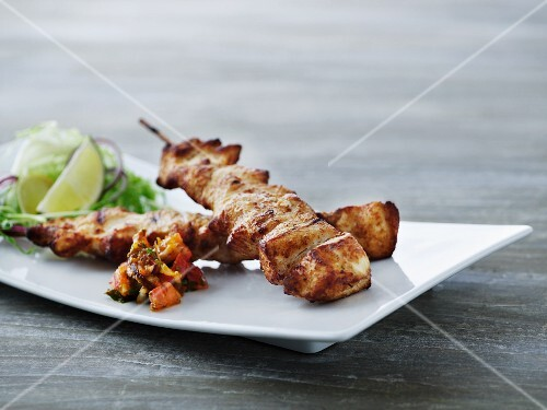 Chicken skewers with relish and salad