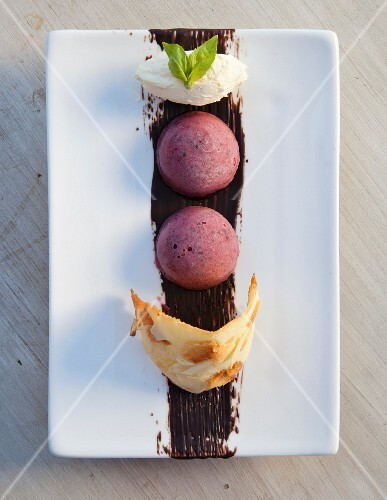 Berry and basil sorbet with an almond wafer and mascarpone