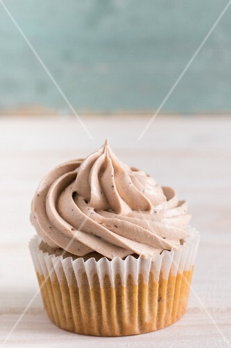 A hazelnut cupcake topped with buttercream