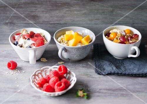 Berry muesli, amaranth muesli with mango and quark muesli with physalis