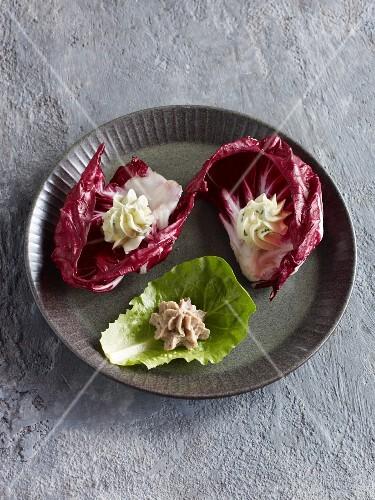 Various homemade spreads served in lettuce leaves