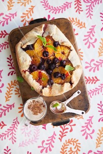 Mandarin and cherry tart with cinnamon and vanilla sauce