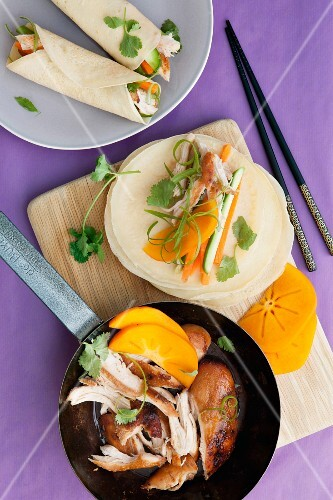 Chicken in a persimmon marinade with coriander in pancakes