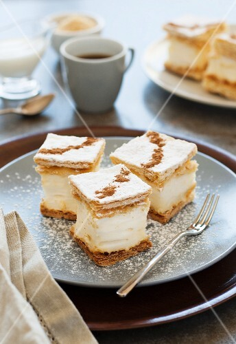 Mil folhas (puff pastry pudding cakes, Portugal) with icing sugar and cinnamon served with coffee