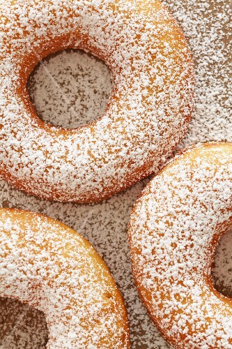 Home-made doughnuts dusted with icing sugar (seen from above)