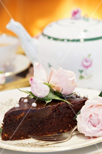 Chocolate cake and tea with an open fire in the background