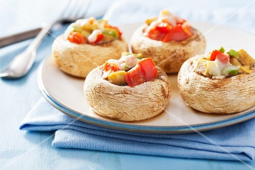 Mushrooms filled with tomatoes and avocado