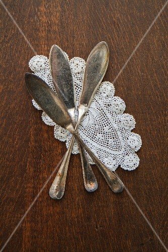Fish knives on a doily