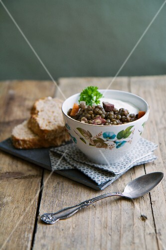 Lentil stew with bacon, carrots and creme fraiche