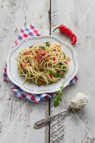Spaghetti with bacon, chilli, mascarpone, rocket and capers