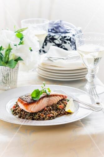 Crispy fried salmon on a lentil medley