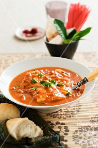 Saffron soup with poached cod