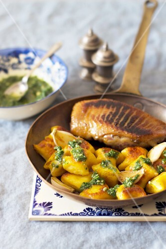 Fried duck breast with pumpkin gnocchi and green mint sauce