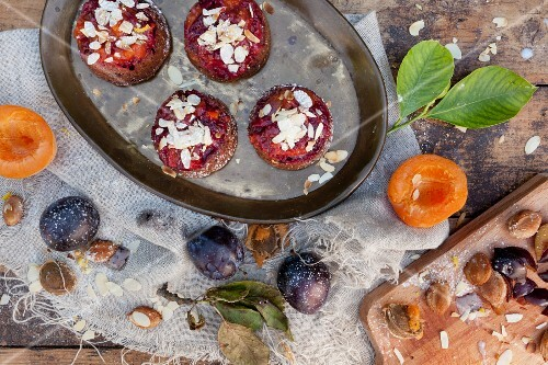 Vegan cupcakes with apricots and plums on a rustic table