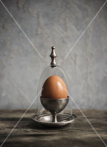 An egg in an antique egg cup