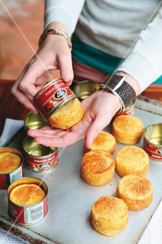 Corn bread being removed from a jar