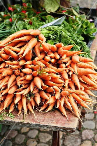 A pile of carrots at a market