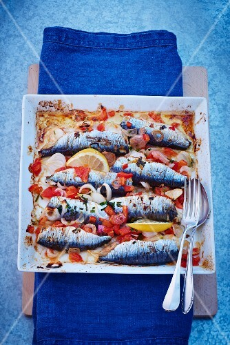 Oven-roasted sardines with tomatoes and lemon