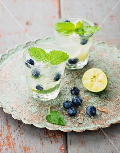 Limeade with blueberries and lemon balm